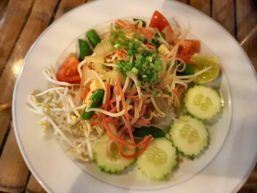 Vegan phad thai on a white plate