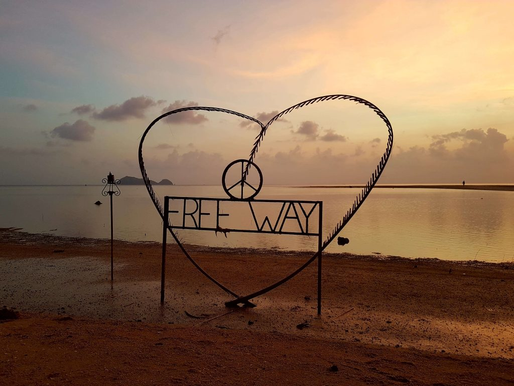 beach with a heart sign that says free way