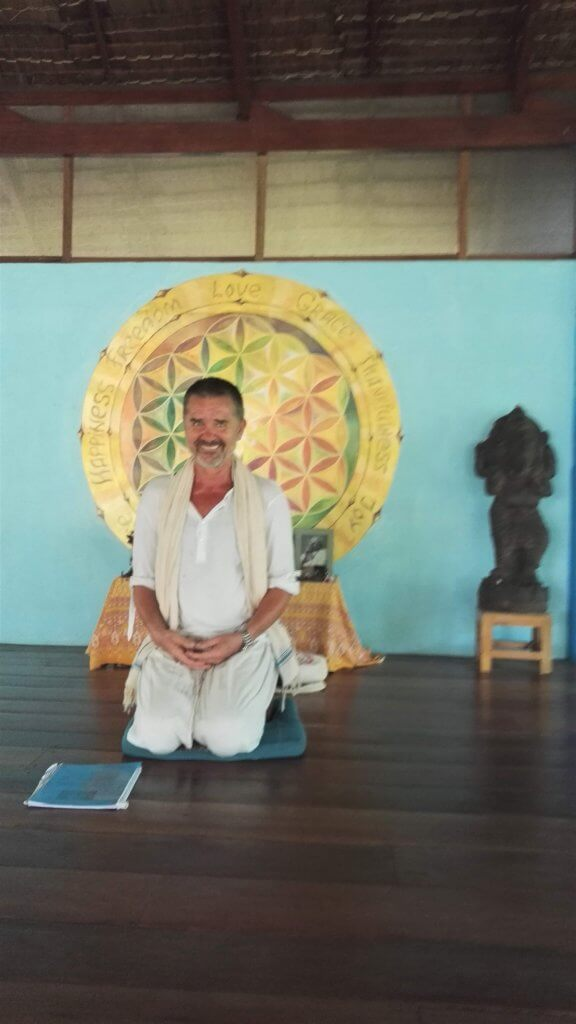 Our Hindu philosophy teacher during the yoga teacher training sitting and smiling