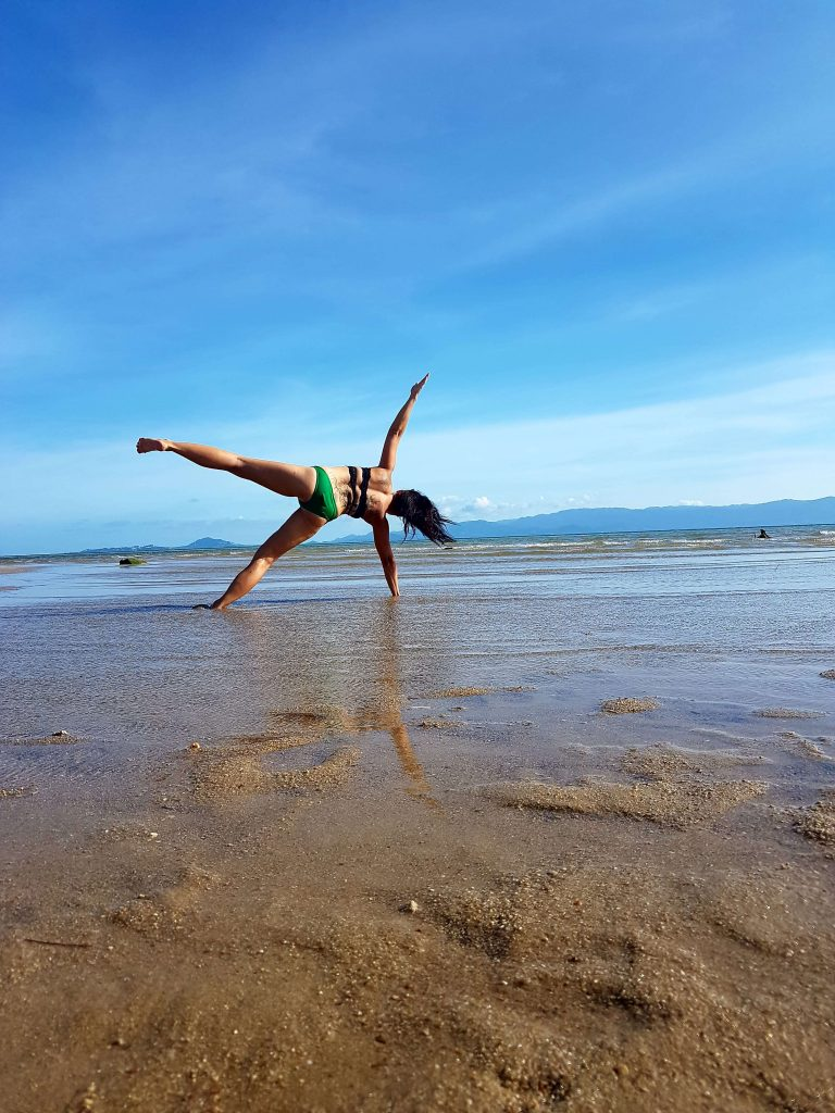 Yoga fun during yoga teacher training on the beach