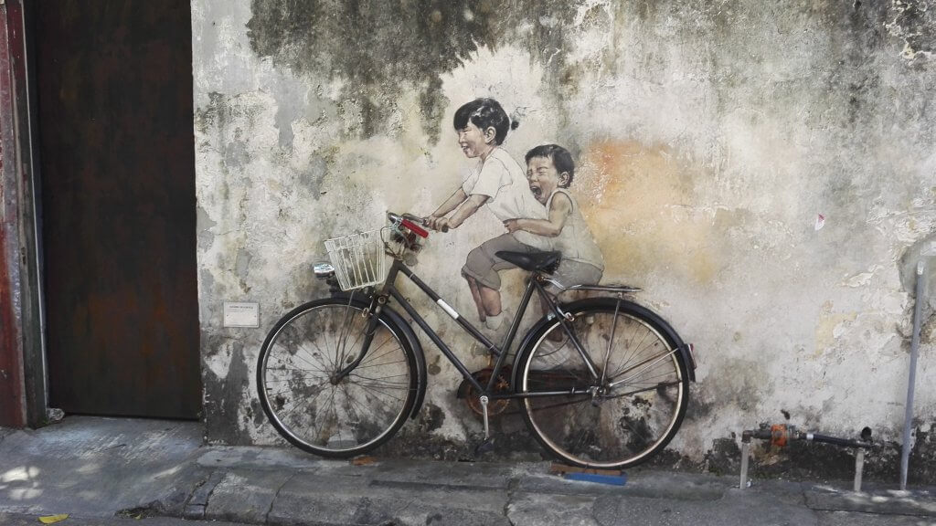 Penang street art with children riding a bicycle