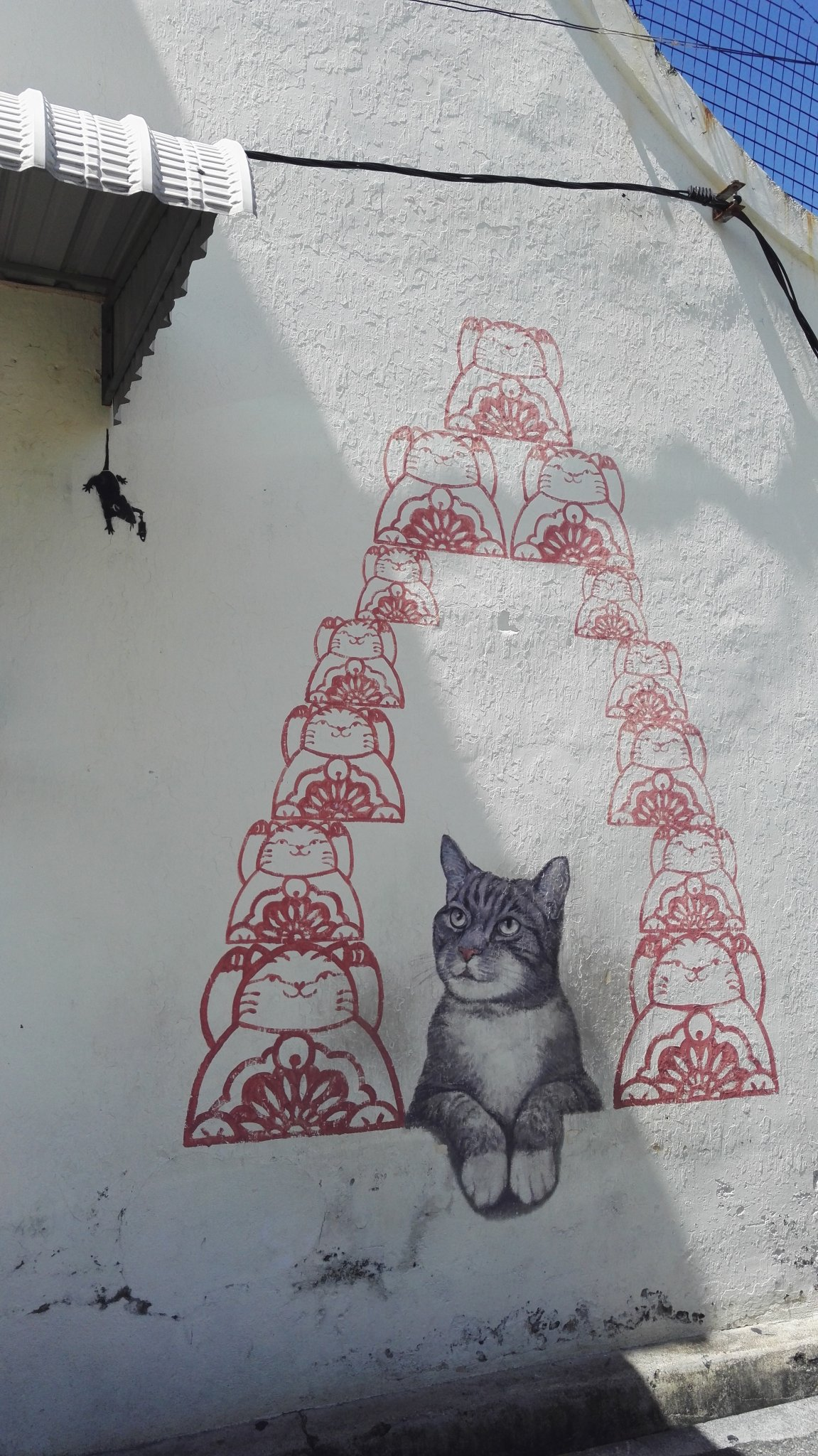 Penang visa run offers possibilities for seeing awesome street art, like this Cat themed mural