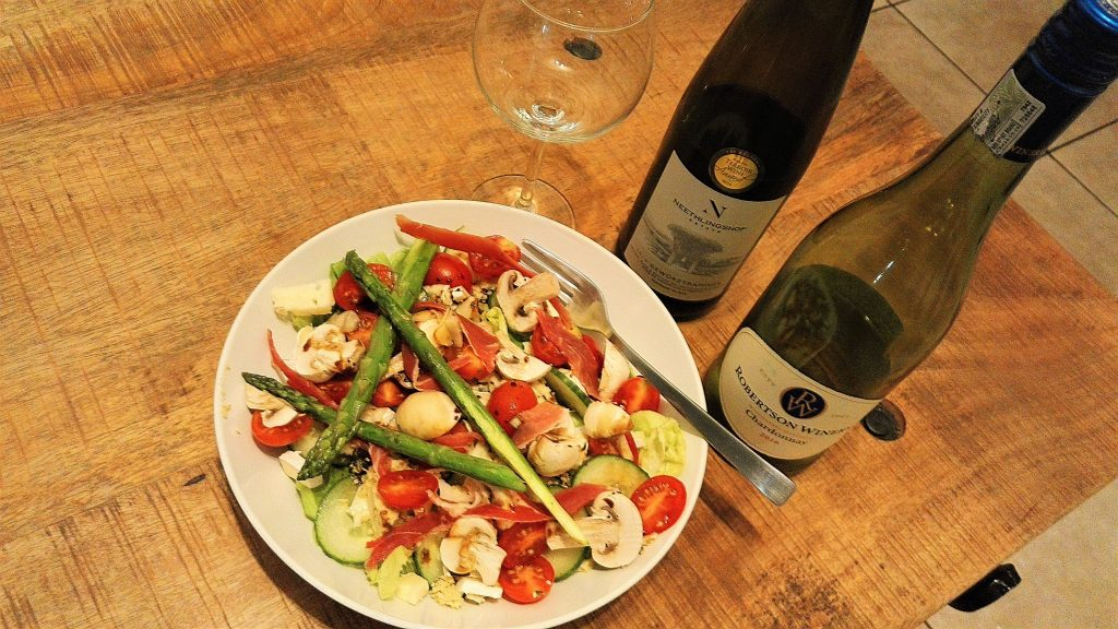two bottles of wine and a salad