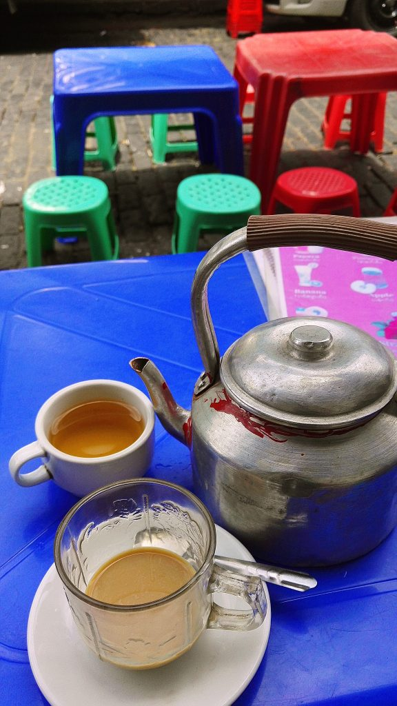 In Yangon city you will be drinking a lot of tea on the street like in the pictures's teapot on a colourful street side plastic tables and chairs