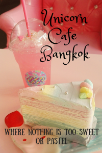A pastel coloured piece of cake with a pink soda