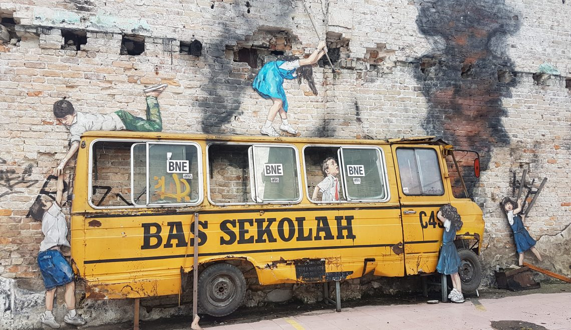 A mural representing unruly school children in a school bus