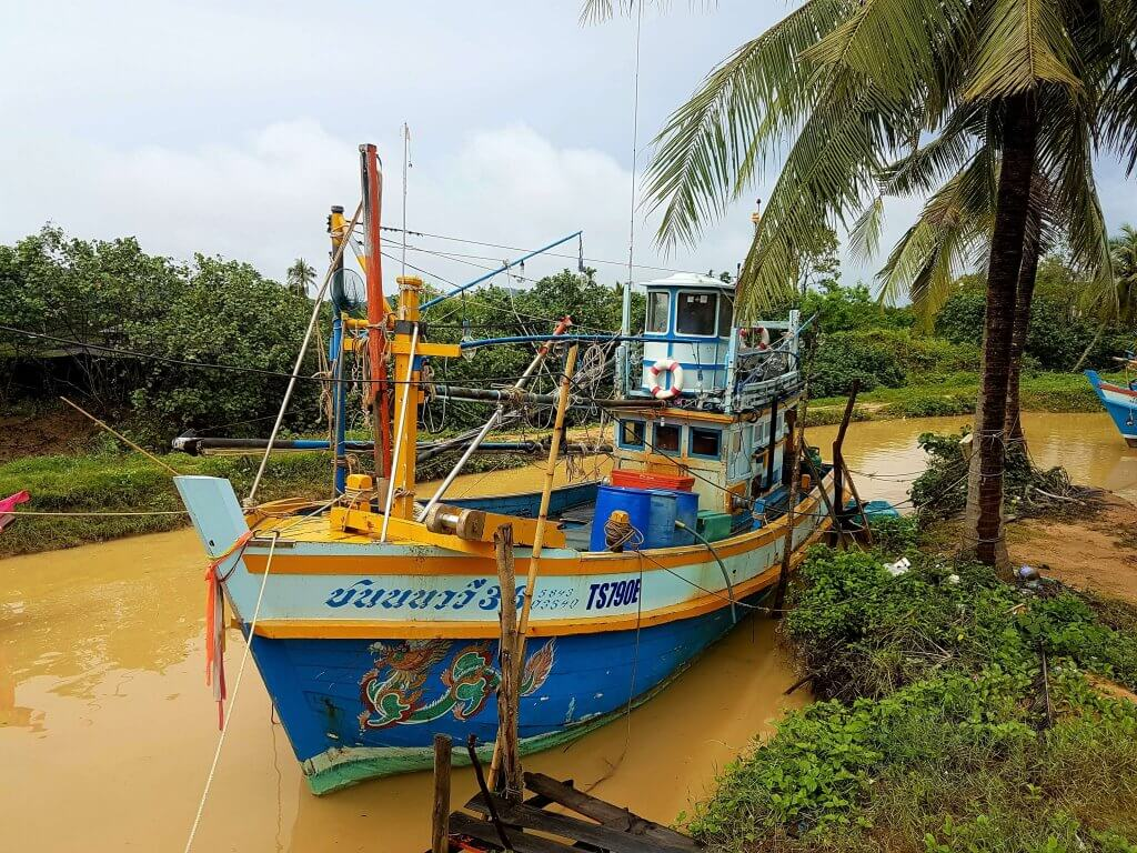 A blue fishing boat at the market