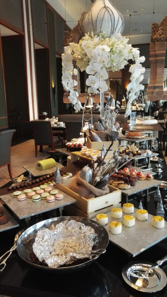 A buffet table full of cakes and pastries