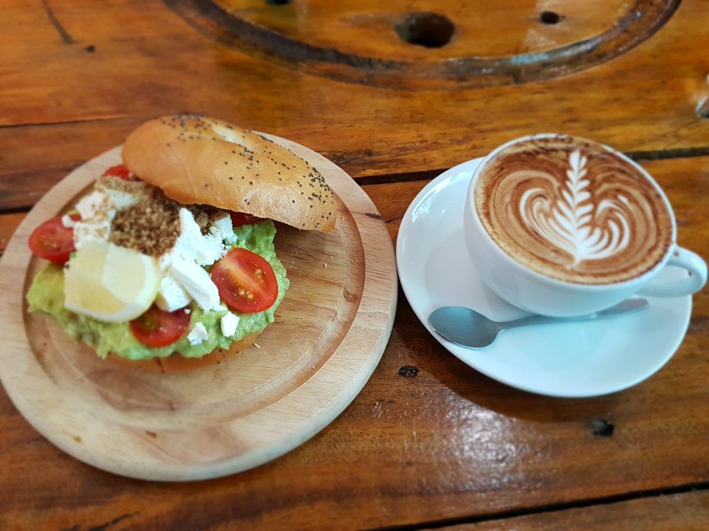 Avocado bagel and a cappuccino