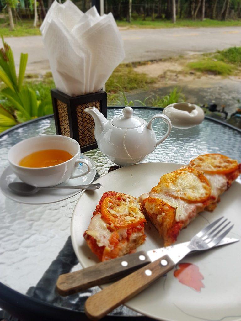A crispy baguette and a teapot at Julien's