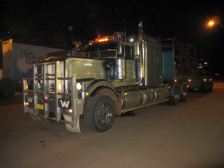A massive road train at night