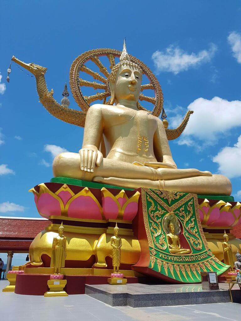 Golden Big Buddha against blue skies