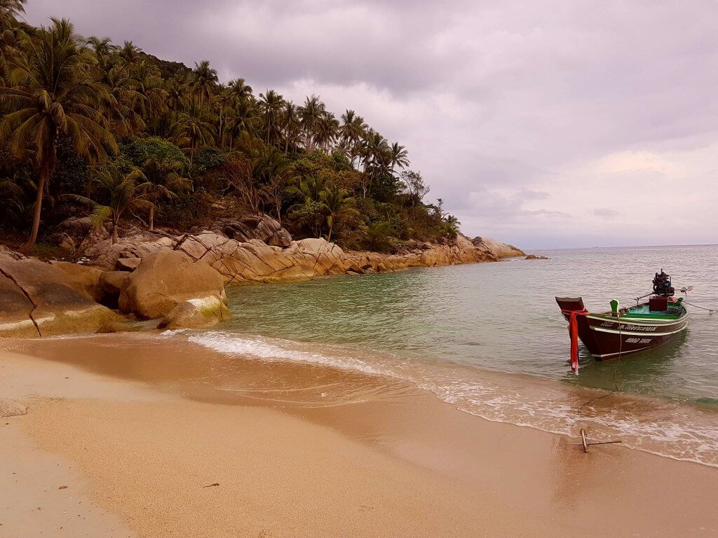 Beach and a Thai longtail boat