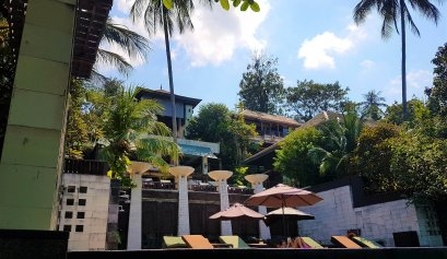 The Kala Samui main building photographed from the pool area