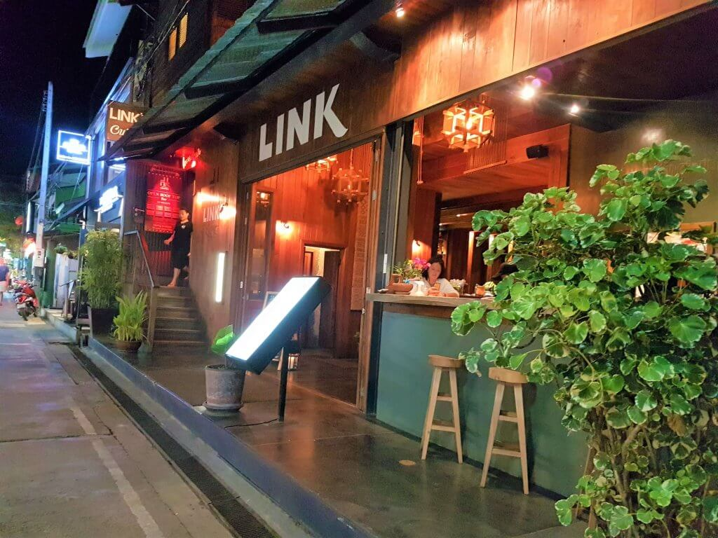 A wooden and modern entrance to Link restaurant