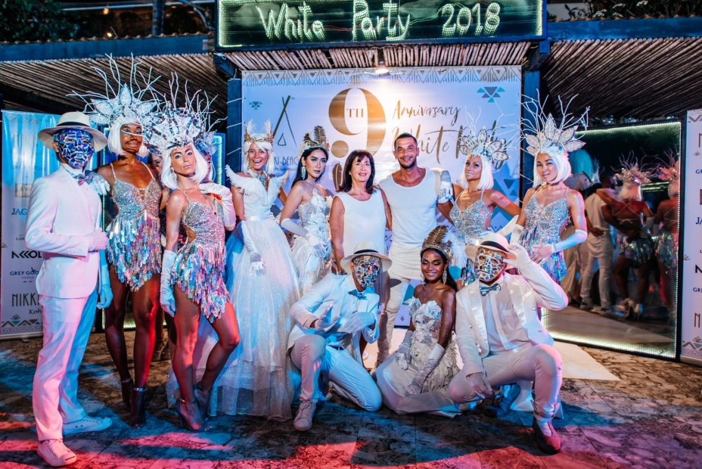 People dressed up spectacularly in white and sequins for White Party