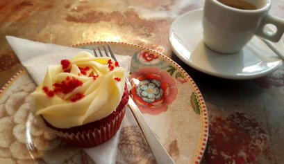 Red Velvet cupcake with an espresso served beautifully