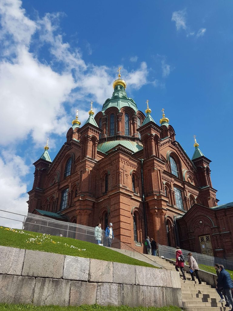 Red tiled Uspenski Cathedral with clear blue skies