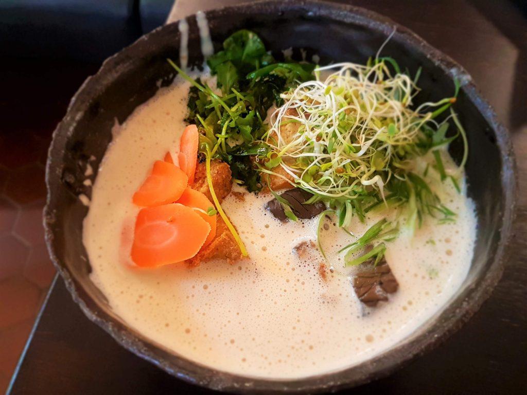 Delicious Finnish Jalotofu ramen soup in a black bowl