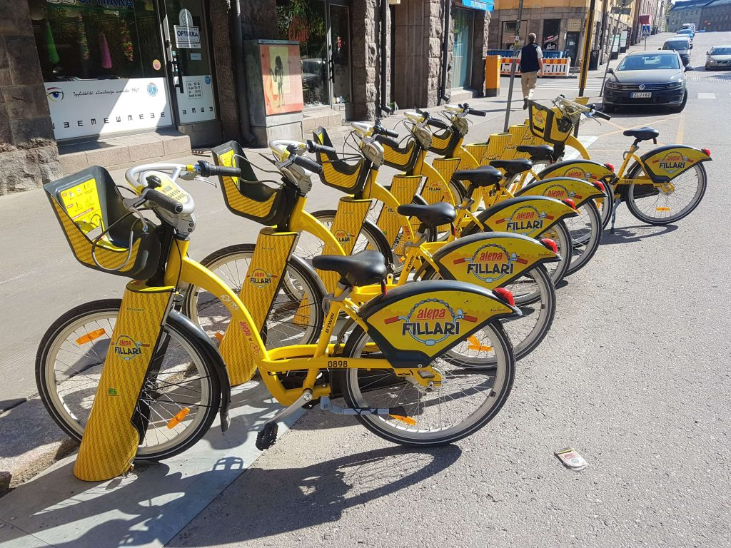 A line of the wonderful, yellow, easy to use Citybikes!
