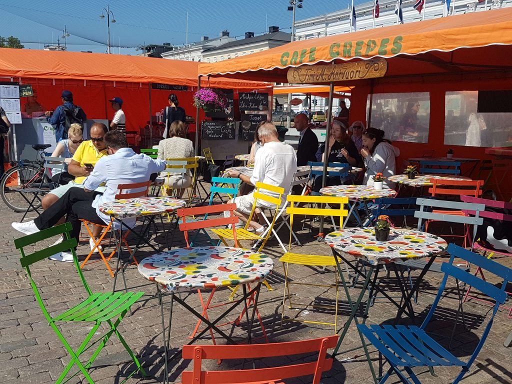 Colouful tables and chairs at the pop up cafe at the market place