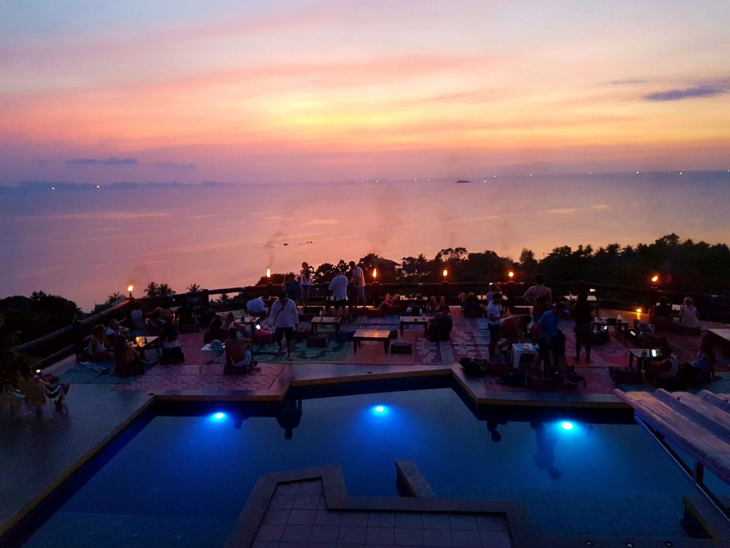A sunset view with a pool