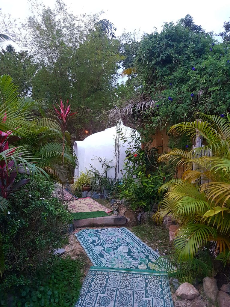 white dome shaped sauna in the jungle