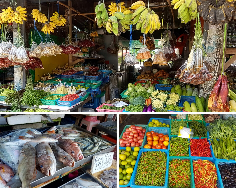 Fruits, vegetables and fresh fish at market stalls