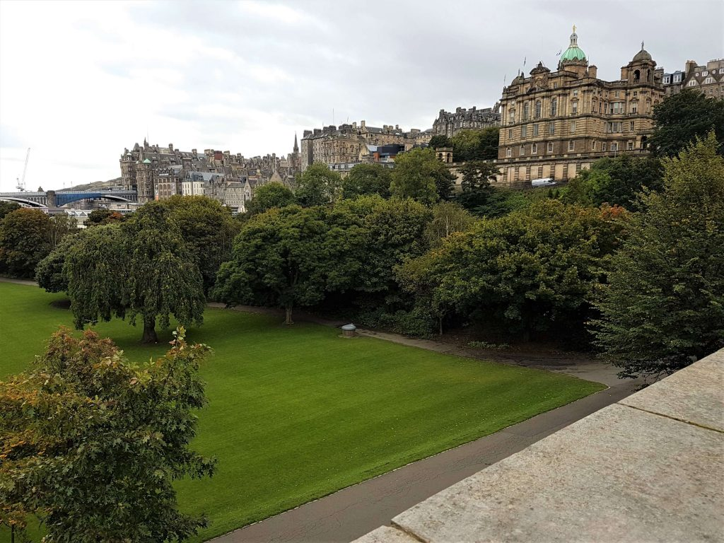 The very lush and green Princes Street Gardens with the Old Town in the background
