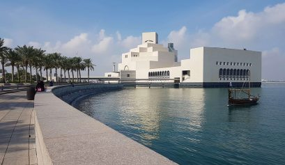 Museum of the Islamic Art in Doha: a white building in the background against an seafront promenade