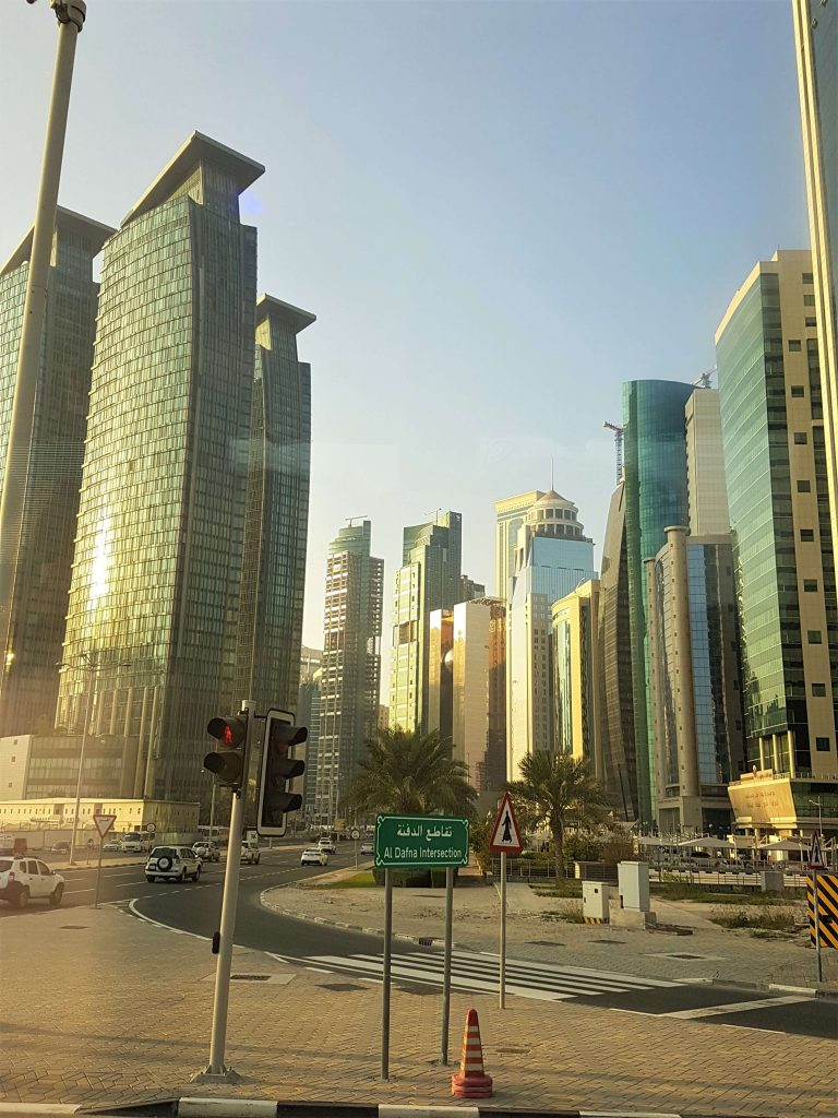 Doha city with skyscrapers in the afternoon sun