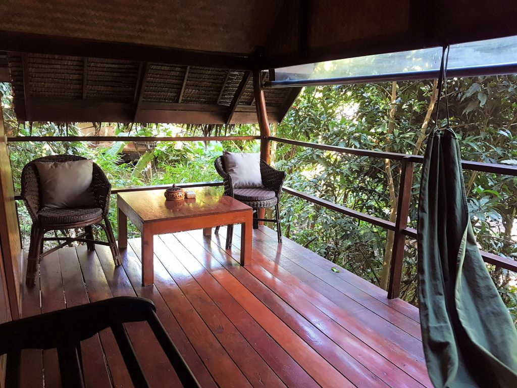 The cute and cozy balcony with a hammock and jungle views
