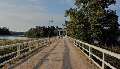 The lovely white bridge on a summer day taking you to the outdoor museum